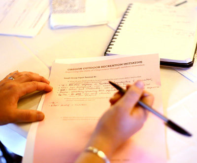 Image of a hand taking notes
