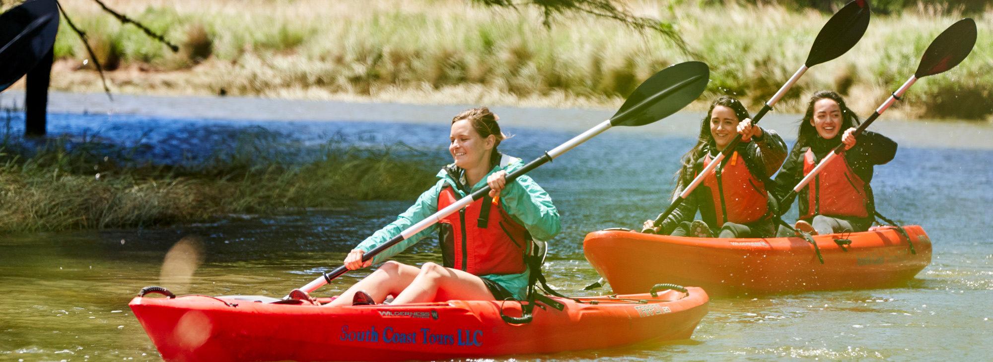 Three women kayaking