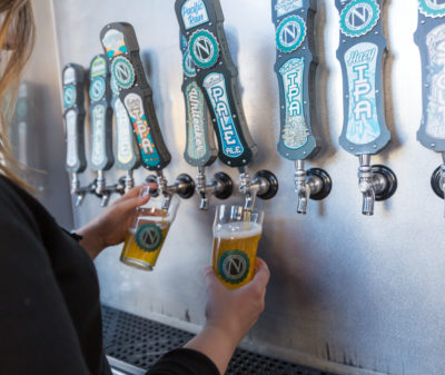 Taps being poured at Ninkasi Brewing Company in Eugene