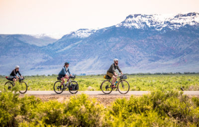 Three cyclists riding in Oregon's Outback roads