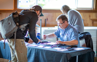 Man registering at a conference
