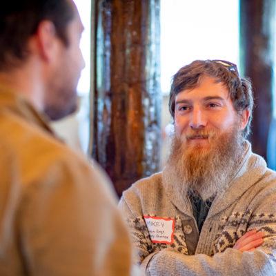 Men talking at a conference