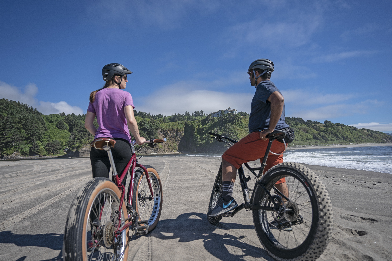 Two people fat biking on the Oregon Coast