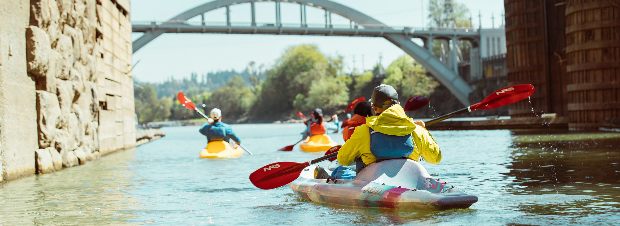 kayaking the willamette river near a bridge
