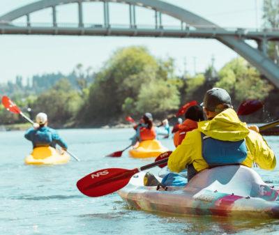 kayaking the willamette river near a bridge