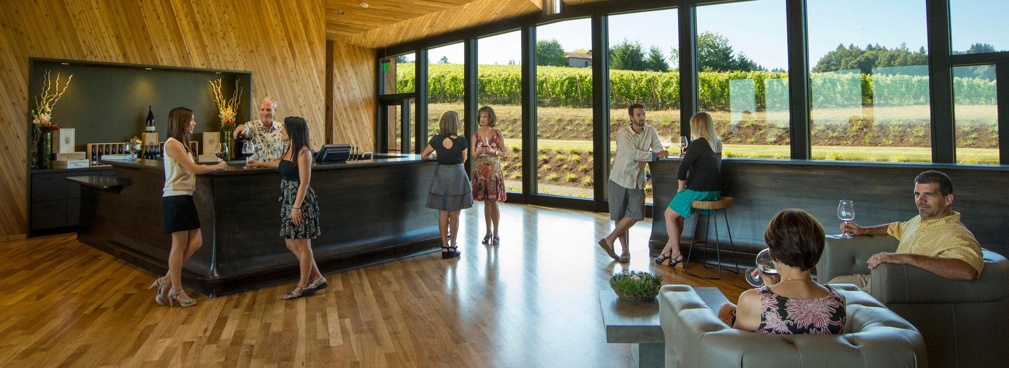wine tasting in a clean, modern tasting room.