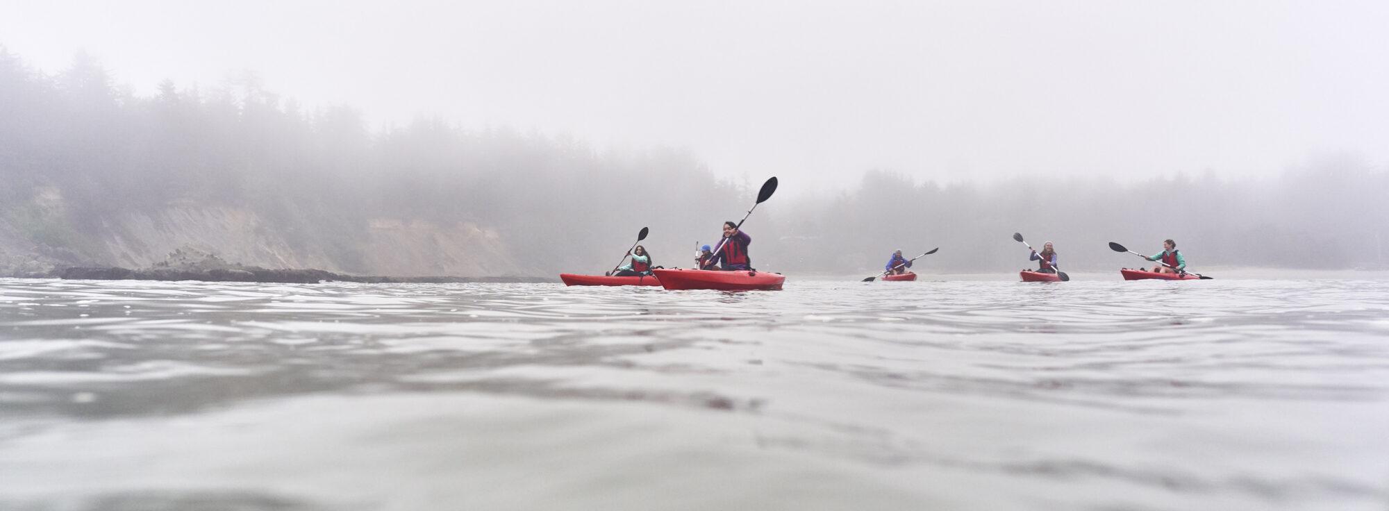 people kayaking on the oregon coast overcast