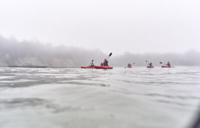 people kayaking on the oregon coast overcast