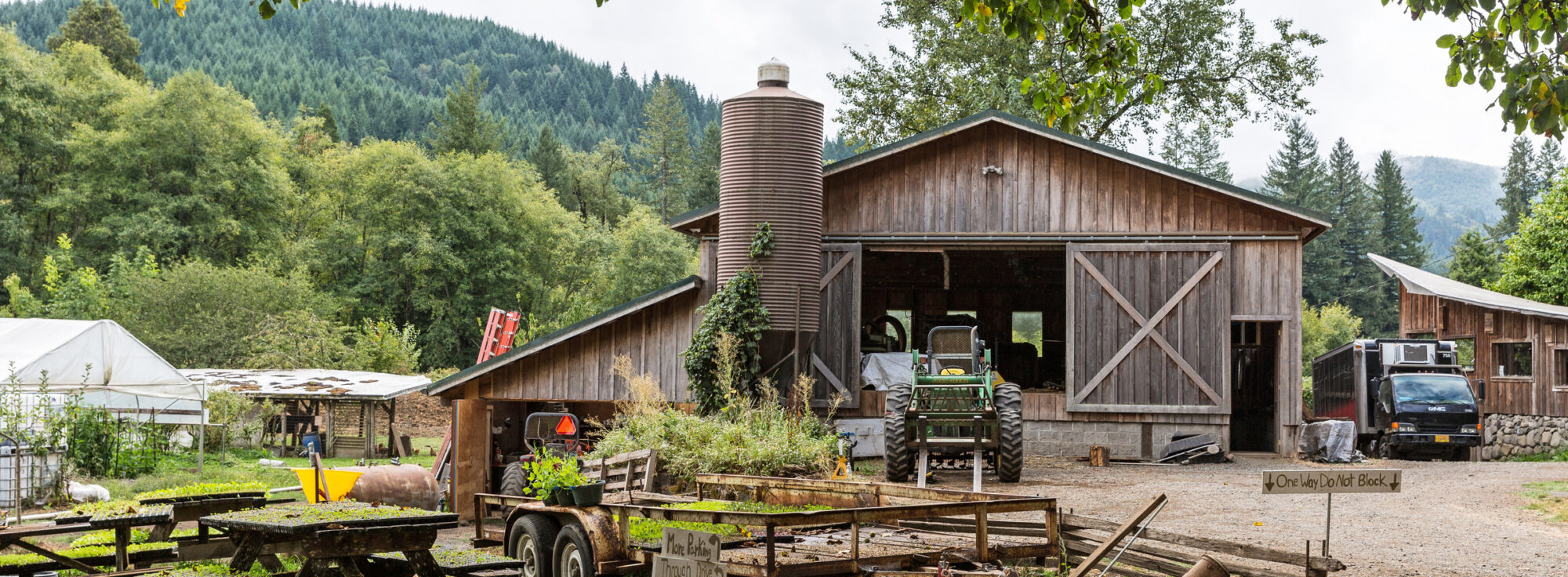 Rustic wood barn with tractor