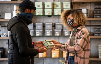 Two masked customers shopping for tea at Smith Tea in Portland.