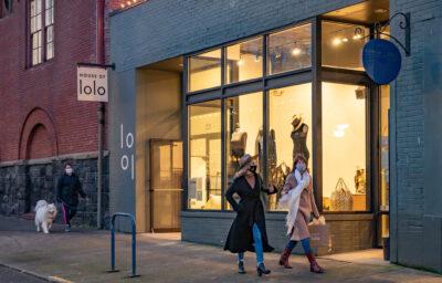 Two women wearing masks shopping downtown Portland.