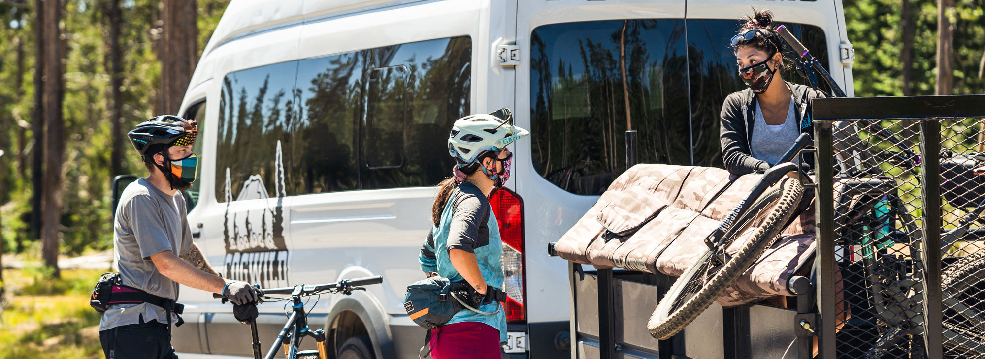 Cyclists unloading bikes from Cogwild tour van.