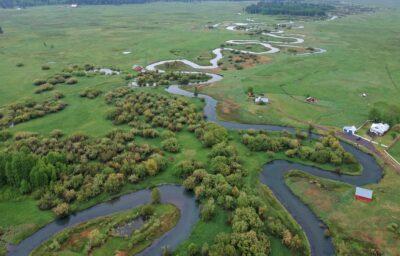 Winding creek through farmland in Klamath Falls.
